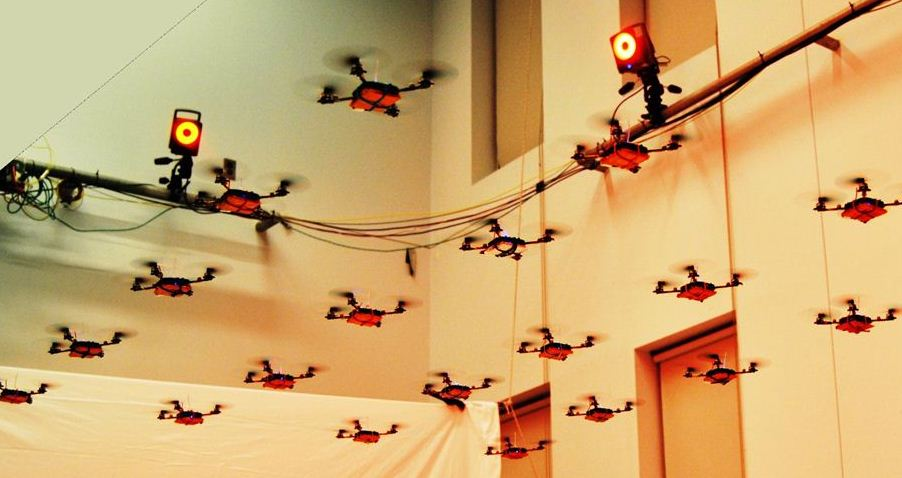 A squadron of tiny quadcopters: must-see video!