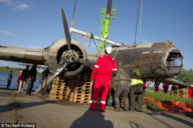 Raised from the depths: German seaplane recovered from fjord 70 years after it sank in such good condition it could even fly again