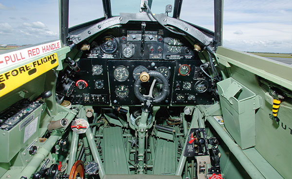 "The Hurricane's ""office"" was notably roomier than the Spitfire's but used the same central panel of essential instruments including ASI, altimeter, vertical speed, artificial horizon, turn and bank, and gyro compass. (Photo by John Dibbs/planepicture.com)"