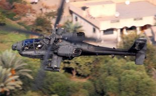 "Photo by Chief Warrant Officer 4 Daniel McClinton, 1st ACB October 15, 2007  An AH-64D Apache from Company B, 1st ""Attack"" Battalion, 227th Aviation Regiment, 1st Air Cavalry Brigade, 1st Cavalry Division, flies over a residential area in the Multi-National Division-Baghdad area Oct. 12. The Apache crew was conducting a reconnaissance mission to keep an eye out for enemy mortar and anti-aircraft systems."