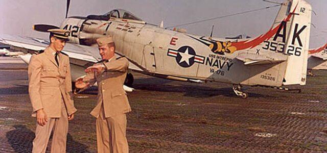 Lieutenant Junior Grade William Thomas Patton recounts his MiG kill with his wingman in front of his Skyraider.